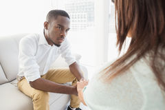 Therapist advising his listening patient stock images
