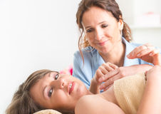 Therapist applying acupuncture needle Royalty Free Stock Photos