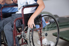Therapist with boy in wheelchair. Male Therapist with boy in wheelchair Stock Image
