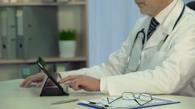 Therapist checks electronic medical records on tablet, technologies, healthcare. Stock footage stock footage