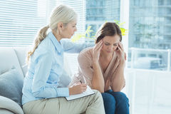 Therapist comforting her patient Stock Photography
