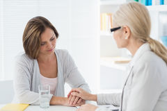Therapist comforting woman Royalty Free Stock Photos