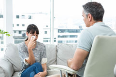Therapist consoling a woman. Therapist consoling a women in the clinic Royalty Free Stock Photos