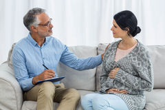 Therapist consoling a woman Stock Images