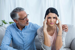 Therapist consoling a woman Royalty Free Stock Photos