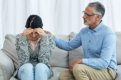 Therapist consoling a woman Stock Image