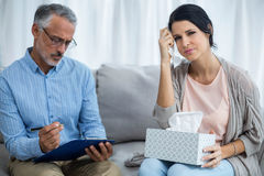 Therapist consoling a woman Stock Photography