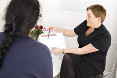 Therapist with customer at body shape clinic Stock Photography