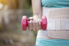Therapist doing arm exercises with dumbbells for improving arm a. Nd back strenght, healthy concept Royalty Free Stock Images