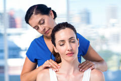 Therapist doing back massage to her patient Stock Images
