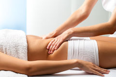 Therapist doing curative belly massage on female patient. Close up of osteopath doing manipulative abdomen massage on female patient Royalty Free Stock Photography