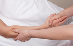 Therapist doing deep tissue recovery massage. A therapist doing deep tissue recovery massage on a woman's forearm Stock Image