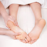 Therapist doing feet massage Stock Images