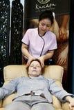 Therapist doing massage Stock Photos