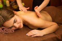 Therapist doing massage Stock Image
