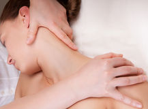Therapist doing massage on a woman's neck Stock Photography