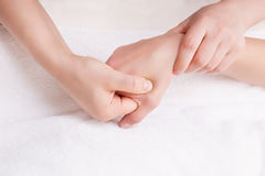 Therapist doing a massage on the womans hand Royalty Free Stock Photo