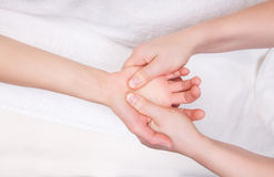 Therapist doing therapeutic palm massage Royalty Free Stock Photos