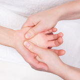 Therapist doing therapeutic palm massage Stock Images