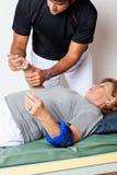Therapist Examining Woman's Hand Stock Photo