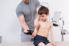 Therapist exercising with little patient Stock Photo