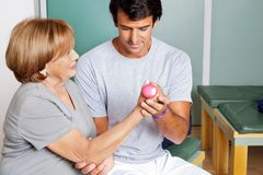 Therapist Giving Muscle Training Stock Photography