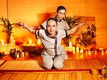 Therapist giving stretching massage to woman. Royalty Free Stock Images