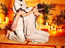Therapist giving stretching massage to woman. Therapist giving Thai stretching massage to woman Royalty Free Stock Photos