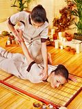 Therapist giving stretching massage to woman. Stock Photography