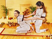 Therapist giving stretching massage to woman. Stock Image