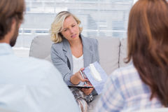 Therapist giving tissue to a woman Royalty Free Stock Images