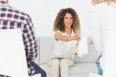 Therapist handing a tissue to woman at couples therapy Royalty Free Stock Image