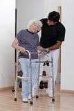 Therapist helping Patient use Walker Stock Photography