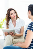 Therapist listening her patient and holding tablet Royalty Free Stock Image