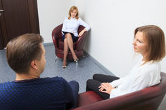 Therapist listening her patients and taking notes Royalty Free Stock Image