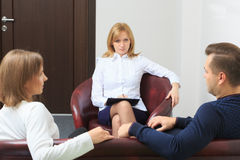 Therapist listening her patients and taking notes Royalty Free Stock Photo