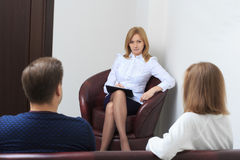 Therapist listening her patients and taking notes Stock Photo