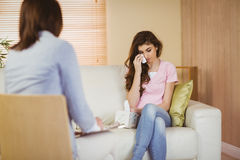 Therapist listening to her crying patient. In therapists office Stock Image