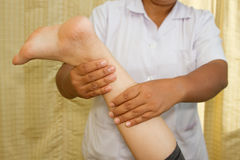 Therapist Massage of a woman's calf muscle Stock Images