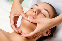 Therapist massaging female chin. Royalty Free Stock Photography