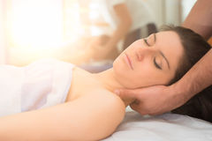Therapist massaging the neck of woman Stock Image