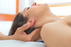 Therapist massaging the neck of woman. In the studio Royalty Free Stock Images