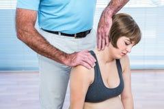 Therapist massaging pregnant woman Royalty Free Stock Photo