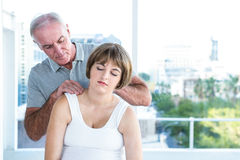 Therapist massaging pregnant woman Stock Photos