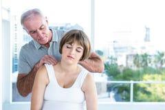 Therapist massaging pregnant woman Stock Photos