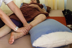 The therapist is massaging woman leg Royalty Free Stock Image