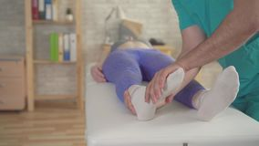 Therapist orthopedist treats flat feet athletes patient stock video