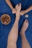 Therapist in reflexology foot massage, spa foot treatment, Stock Photography