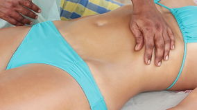 Therapist`s hands doing tummy massage. On woman stock video