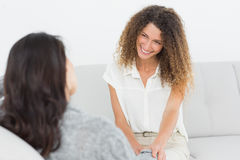 Therapist smiling at her patient Royalty Free Stock Images